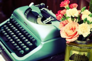 blue-typewriter-white-pink-flowers